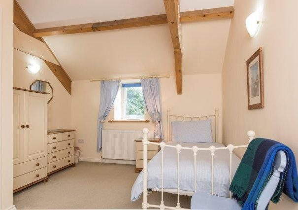 A bedroom at Lavender Cottage