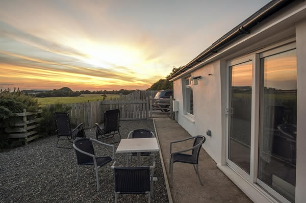 Sunset at Ballacamaish self catering farmstay cottages
